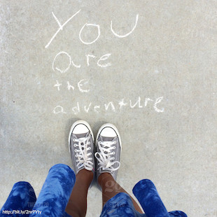 Tennis shoes on pavement - you are the adventure.