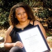 Lexandra, holding National Honor Society Certificate