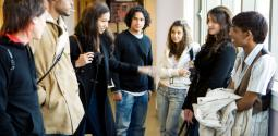 Group of students talking in the hallway