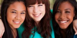 Three young women smiling