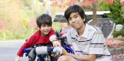 Boy and his younger brother with mobility issue