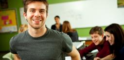 Young man standing in classroom