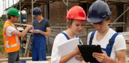 Two young women working on a construction site