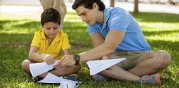 A young man helping a boy with homework