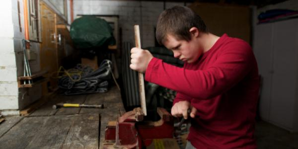 Man with disability working in a workshop
