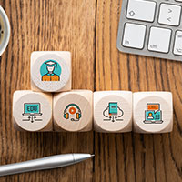Wooden blocks with icons of different jobs