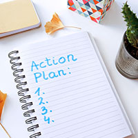Notebook labeled Action Plan